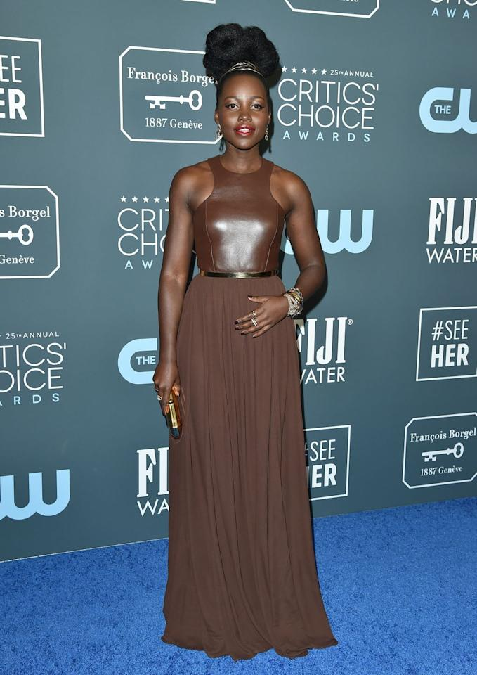 <p>At the Critics' Choice Awards in January this year, wearing a custom leather Michael Kors dress, accessorised with a stack of Pomellato chain bracelets and earrings. </p>