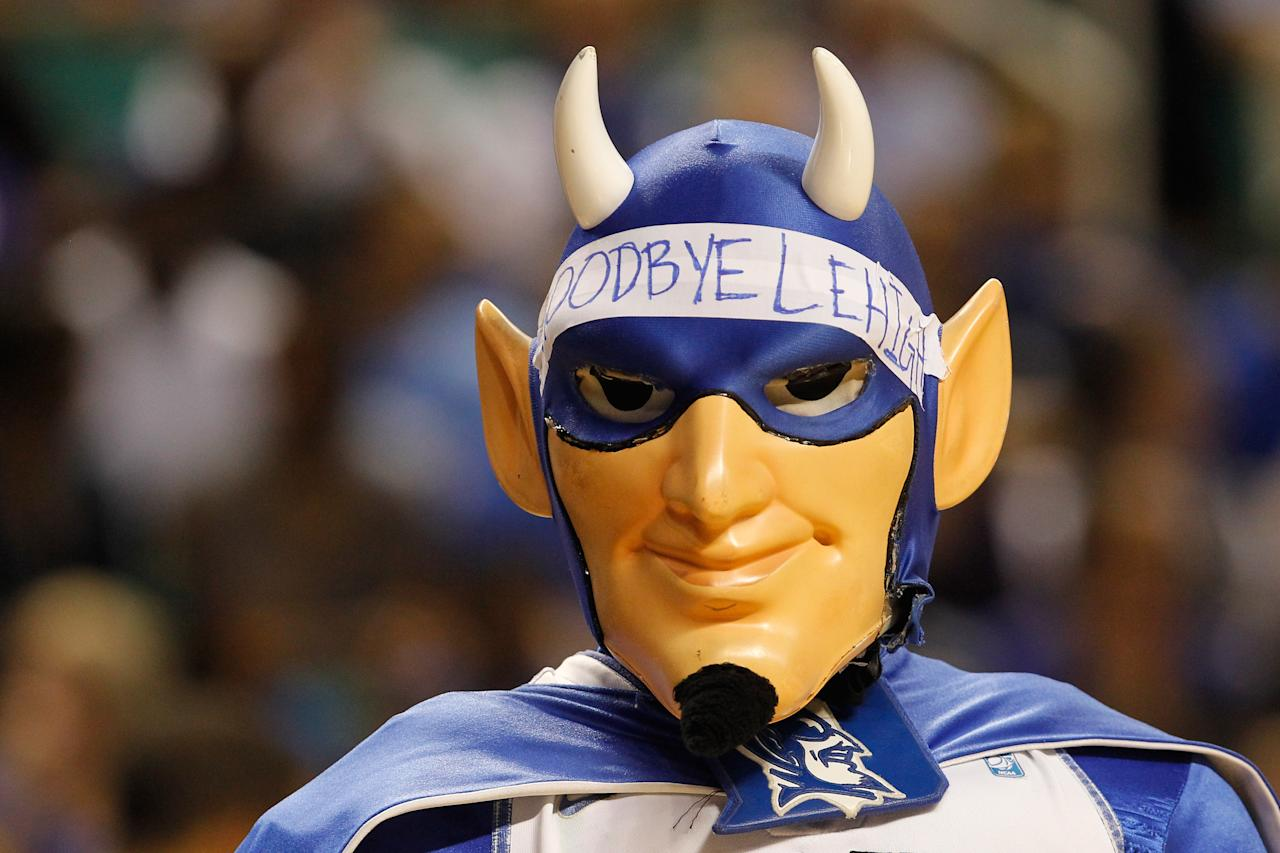 """GREENSBORO, NC - MARCH 16:  The Duke Blue Devils mascot wears a """"Goodbye Lehigh"""" head band as the Blue Devils take on the Lehigh Mountain Hawks during the second round of the 2012 NCAA Men's Basketball Tournament at Greensboro Coliseum on March 16, 2012 in Greensboro, North Carolina.  (Photo by Streeter Lecka/Getty Images)"""