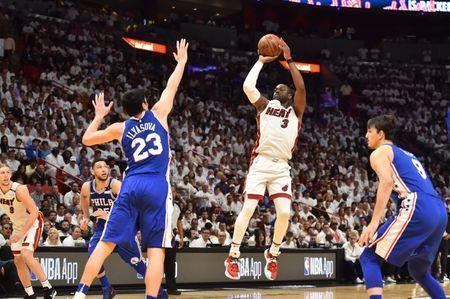 Apr 19, 2018; Miami, FL, USA; Miami Heat guard Dwyane Wade (3) attempts a shot against the Philadelphia 76ers during the second half in game three of the first round of the 2018 NBA Playoffs at American Airlines Arena. Mandatory Credit: Jasen Vinlove-USA TODAY Sports