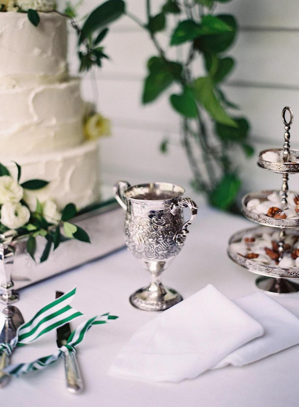 This is our Ramsay Family wedding Loving Cup. It has everyone in the family's names and wedding dates engraved on it. After we cut the cake, we drank champagne from the cup.
