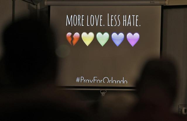 <p>A screen message during a prayer vigil at the Joy Metropolitan Community Church, June 12, 2016, in Orlando, Fla. (AP/Chris O'Meara) </p>
