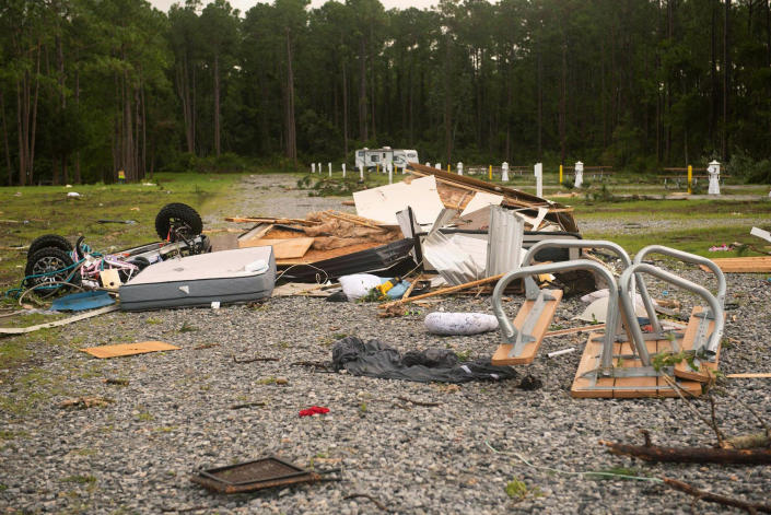 Debris covers the ground after a tornado struck Wednesday, the on-base RV park on Naval Submarine Base Kings Bay on Thursday, July 8, 2021 in Kings Gay, Ga. Severe weather from Tropical Storm Elsa spurred tornado warnings in Delaware and New Jersey early Friday as the system moved over the mid-Atlantic states and into the northeastern United States. (Mass Communication 3rd Class Aaron Xavier Saldana/U.S. Navy via AP)