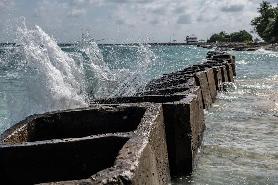 Concrete blocks are placed along the shoreline to try and prevent further coastal erosion, on December 17, 2019 in Mahibadhoo, Maldives.  (Getty Images)