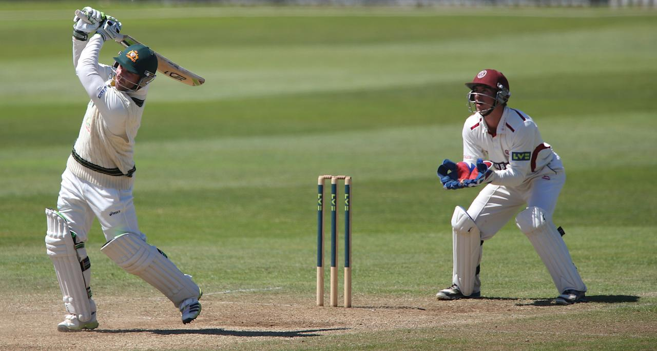 Australia's Phil Hughes scores a 6 watched by Somerset wicketkeeper Alex Barrow during the International Tour match at the County Ground, Taunton.