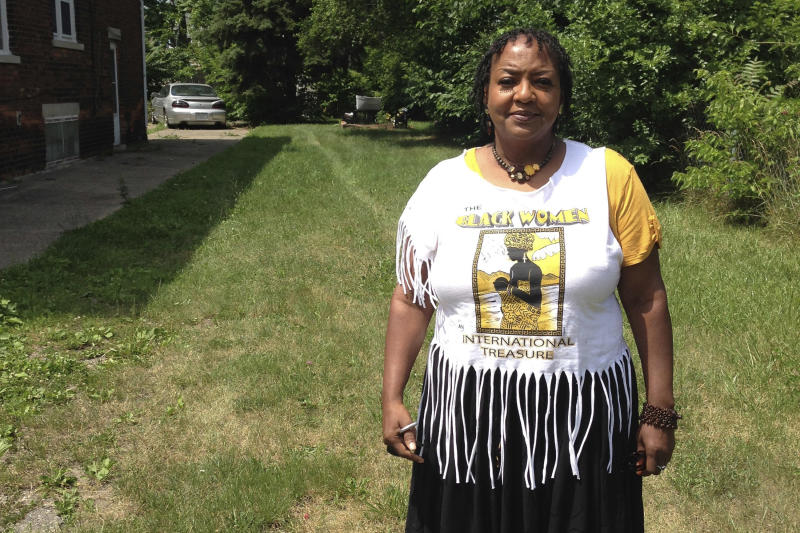 """In this July 6, 2017 photo, Deborah Chenault Green discusses Detroit's 1967 riots from a vacant lot where her cousin's home once stood on the city's west side. Green, 62, was 12 years old and spending the night at the home when the riot started on July 23, 1967. """"The national guard was going into people's houses,"""" Green said. """"I could remember the first time I heard a tank coming down 12th Street. It scared us to death because it shook everything. I always heard shooting during that time. During the riots was the first time we learned how to hit the floor when we heard gunfire."""" Green now lives in St. Clair, northeast of Detroit. (AP Photo/Corey Williams)"""