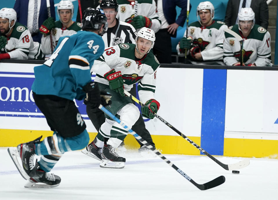 Minnesota Wild center Nick Bonino (13) skates down the ice against San Jose Sharks defenseman Marc-Edouard Vlasic (44) during the second period of an NHL hockey game in San Jose, Calif., Monday, Feb. 22, 2021. (AP Photo/Tony Avelar)