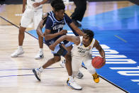 Baylor guard Davion Mitchell (45) drives around Villanova guard Bryan Antoine (1) in the second half of a Sweet 16 game in the NCAA men's college basketball tournament at Hinkle Fieldhouse in Indianapolis, Saturday, March 27, 2021. (AP Photo/Michael Conroy)