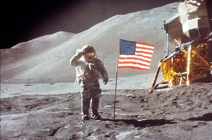 """<p>The flag moving in the wind, no stars in the sky whatsoever, the misaligned shadows—these have all been points made in the conspiracy theory that Neil Armstrong <em>didn't </em>take the first """"leap for mankind"""" on the moon in 1969. For years, <a href=""""https://www.popularmechanics.com/space/moon-mars/a28434260/moon-landing-hoax-conspiracists/"""" rel=""""nofollow noopener"""" target=""""_blank"""" data-ylk=""""slk:conspiracists have argued that NASA staged the landing"""" class=""""link rapid-noclick-resp"""">conspiracists have argued that NASA staged the landing</a> and that the secret has been protected by the CIA ever since. </p>"""