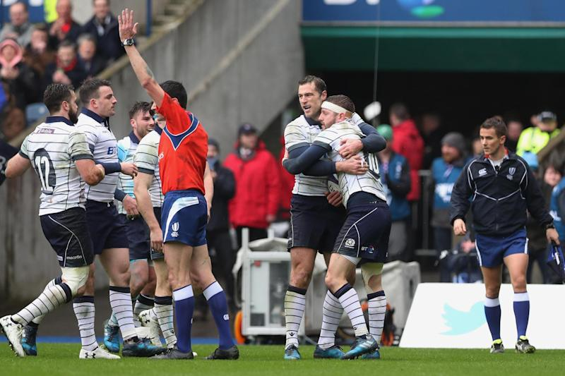 Bonus point: Finn Russel is congratulated by team-mates after scoring Scotland's opening try: Getty Images