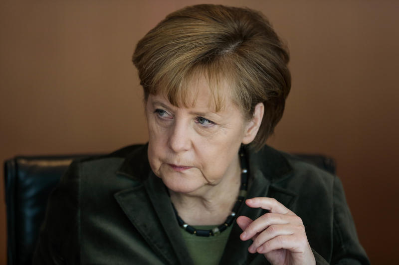 German Chancellor Angela Merkel attends the weekly cabinet meeting at the chancellery in Berlin, Wednesday, Feb. 12, 2014. (AP Photo/Markus Schreiber)