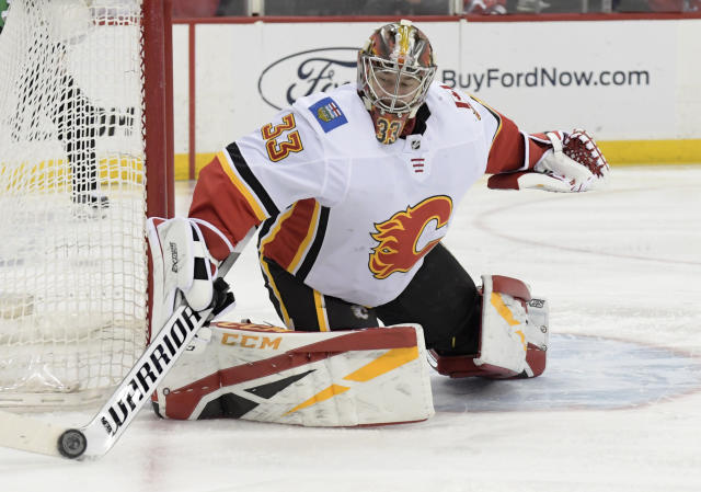 Calgary Flames goaltender David Rittich (33) deflects the puck during the second period of an NHL hockey game against the New Jersey Devils Wednesday, Feb. 27, 2019, in Newark, N.J. (AP Photo/Bill Kostroun)