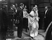 "<p>On her wedding day, photographers crowded around Elizabeth Bowes-Lyon's family residence in London to catch a glimpse at the bride. She opted for a very 1920s-inspired bridal gown, featuring a drop waist and crystal embroidered bodice, <a href=""https://www.wmagazine.com/gallery/royal-wedding-dress-queen-elizabeth-princess-diana-meghan-markle-eugenie/"" rel=""nofollow noopener"" target=""_blank"" data-ylk=""slk:custom made by Queen Mary's dressmaker"" class=""link rapid-noclick-resp"">custom made by Queen Mary's dressmaker</a>. </p>"