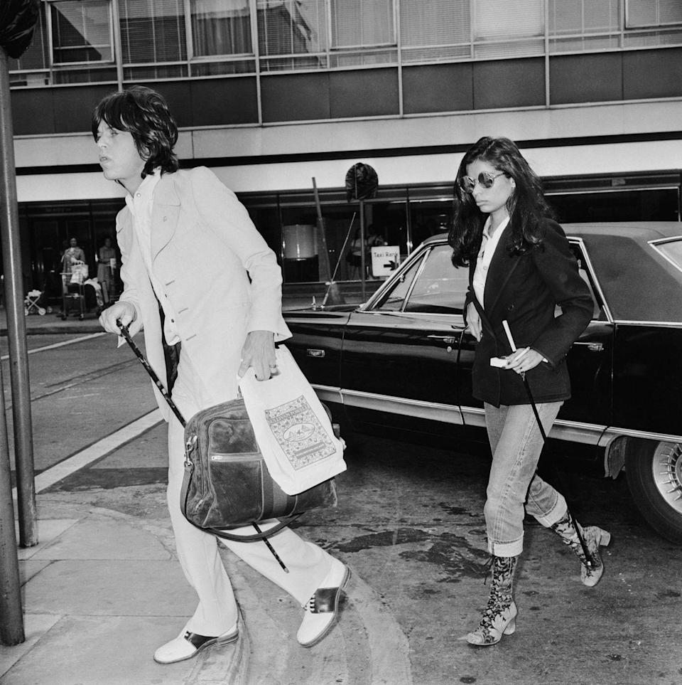<p>Bianca Jagger at London airport to see off husband Mick Jagger as he leaves for a U.S. tour with the Rolling Stones, 24th May 1972.</p>