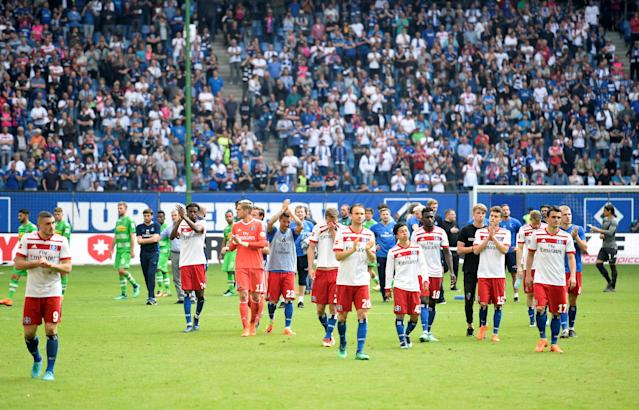 Soccer Football - Bundesliga - Hamburger SV v Borussia Moenchengladbach - Volksparkstadion, Hamburg, Germany - May 12, 2018 Hamburg's Kyriakos Papadopoulos (L) and team mates look dejected as they applaud the fans at the end of the match REUTERS/Fabian Bimmer DFL RULES TO LIMIT THE ONLINE USAGE DURING MATCH TIME TO 15 PICTURES PER GAME. IMAGE SEQUENCES TO SIMULATE VIDEO IS NOT ALLOWED AT ANY TIME. FOR FURTHER QUERIES PLEASE CONTACT DFL DIRECTLY AT + 49 69 650050