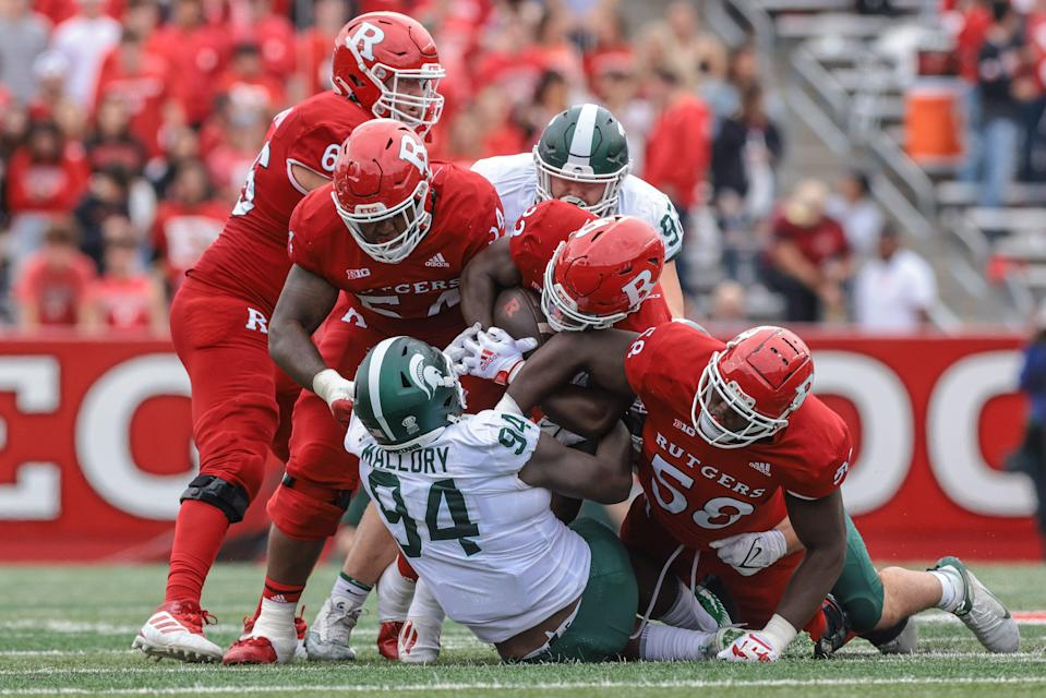 Oct 9, 2021; Piscataway, New Jersey, USA; Rutgers Scarlet Knights running back Kyle Monangai (23) is tackled by Michigan State Spartans defensive tackle Dashaun Mallory (94) as offensive lineman David Nwaogwugwu (58) and offensive lineman Cedrice Paillant (54) block during the second half at SHI Stadium.