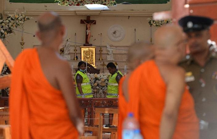 People of different faiths gathered at the St Sebastian's church to pay their respects (AFP Photo/ISHARA S. KODIKARA)