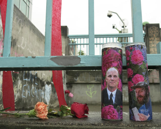 <p>Votive candles bearing the photos of two men who were fatally stabbed on a Portland, Ore., light-train while trying to stop another man from harassing two young women with an anti-Muslim tirade, sit on a rain-soaked memorial on Tuesday, May 30, 2107 in Portland. Taliesin Myrddin Namkai-Meche, 23, and Ricky Best, 53, died in the attack. The suspect, Jeremy Joseph Christian, 35, made a first court appearance on charges of aggravated murder and attempted murder Tuesday in a Portland, Oregon courthouse. (AP Photo/Gillian Flaccus) </p>