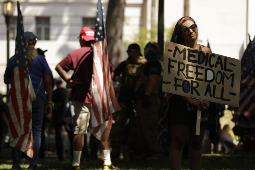 LOS ANGELES, CA - SEPTEMBER 18, 2021 - - Dozens of anti-vax protesters rally in front of City Hall in Los Angeles on September 18, 2021. An anti-vaxxer was stabbed and a reporter was sent to the hospital with a head injury at last month's rally at City Hall. (Genaro Molina / Los Angeles Times)