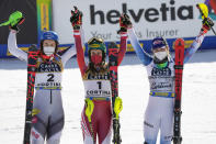 Austria's Katharina Liensberger, center, winner of the women's slalom, poses with second placed Slovakia's Petra Vlhova, left, and third placed United States' Mikaela Shiffrin, at the alpine ski World Championships in Cortina d'Ampezzo, Italy, Saturday, Feb. 20, 2021. (AP Photo/Giovanni Auletta)