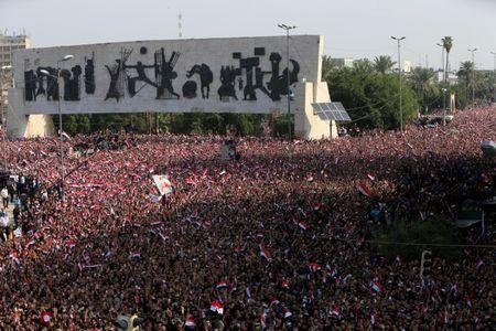 Supporters of Iraqi Shi'ite cleric Moqtada al-Sadr gather during a protest against corruption at Tahrir Square in Baghdad