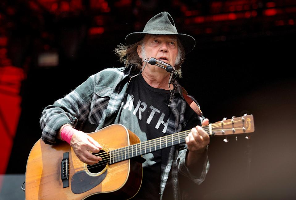 Canadian singer-songwriter Neil Young performs at the Orange Stage at the Roskilde Festival in Roskilde, Denmark, July 1, 2016. Picture taken July 1, 2016.  Scanpix Denmark/Nils Meilvang/via REUTERS  ATTENTION EDITORS - THIS IMAGE WAS PROVIDED BY A THIRD PARTY. FOR EDITORIAL USE ONLY. DENMARK OUT. NO COMMERCIAL SALES.