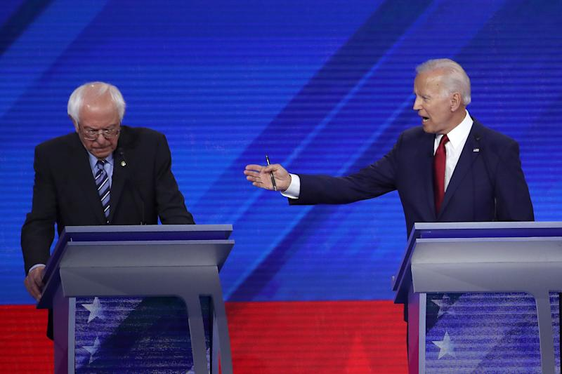 Democratic presidential candidates Sen. Bernie Sanders (I-VT) and former Vice President Joe Biden interact during the Democratic Presidential Debate at Texas Southern University's Health and PE Center on Sept. 12, 2019 in Houston, Texas.