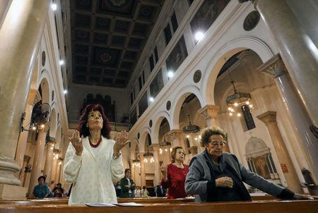 Christian women pray at Saint Joseph's Roman Catholic Church before Pope Francis is scheduled to visit Egypt, in Cairo, Egypt April 23, 2017. Picture taken April 23, 2017. REUTERS/Mohamed Abd El Ghany