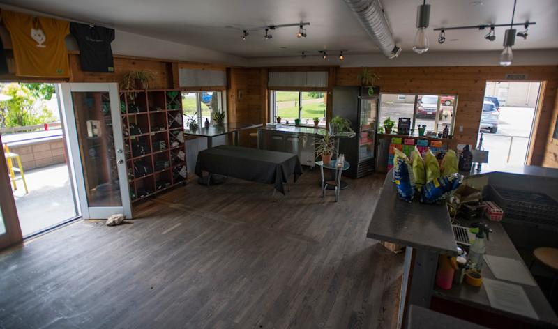 The taproom stands empty at Funkwerks in Fort Collins, Colo., in late May. Bars in Colorado can now reopen after a relaxation of restrictions meant to stave off the novel coronavirus went into effect last Thursday.