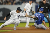 Texas Rangers' Isiah Kiner-Falefa, right, slides past New York Yankees' Gleyber Torres to steal second base during the first inning of a baseball game Wednesday, Sept. 22, 2021, in New York. (AP Photo/Frank Franklin II)