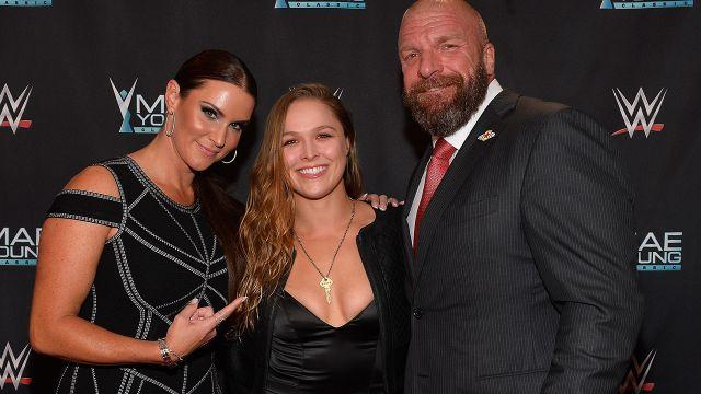 Rousey with WWE bosses Stephanie McMahon and Triple H. Image: Getty