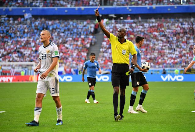 Soccer Football - World Cup - Group A - Uruguay vs Russia - Samara Arena, Samara, Russia - June 25, 2018 Russia's Igor Smolnikov is shown a red card by referee Malang Diedhiou REUTERS/Dylan Martinez