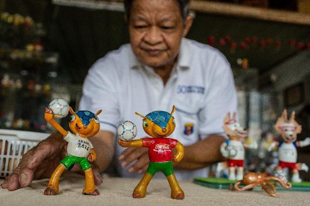 Tam spends hours every day making the models, driven by his football fanaticism (AFP Photo/Thanh NGUYEN)