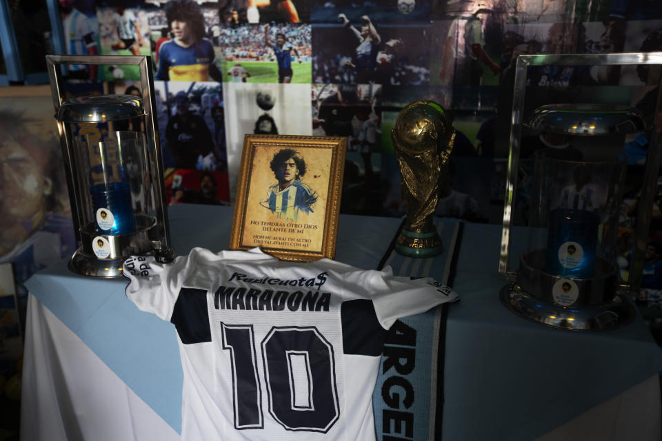An altar with memorabilia sits in the Church of Maradona in San Andres Cholula, Puebla state, Mexico, Sunday, July 18, 2021. The Church of Maradona in Mexico, dedicated to late soccer great Diego Armando Maradona, was founded a few weeks ago by Argentine expatriate Buchet, who also owns the pizza parlor next door. (AP Photo/Marco Ugarte)