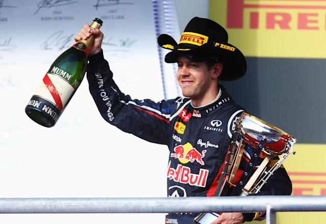 AUSTIN, TX - NOVEMBER 18: Sebastian Vettel of Germany and Red Bull Racing celebrates on the podium after finishing second during the United States Formula One Grand Prix at the Circuit of the Americas on November 18, 2012 in Austin, Texas. (Photo by Paul Gilham/Getty Images)