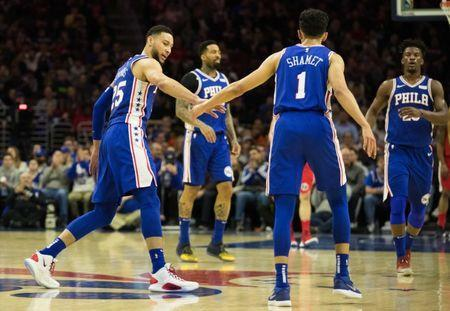 Jan 8, 2019; Philadelphia, PA, USA; Philadelphia 76ers guard Landry Shamet (1) celebrates his three pointer with guard Ben Simmons (25) during the second quarter against the Washington Wizards at Wells Fargo Center. Mandatory Credit: Bill Streicher-USA TODAY Sports