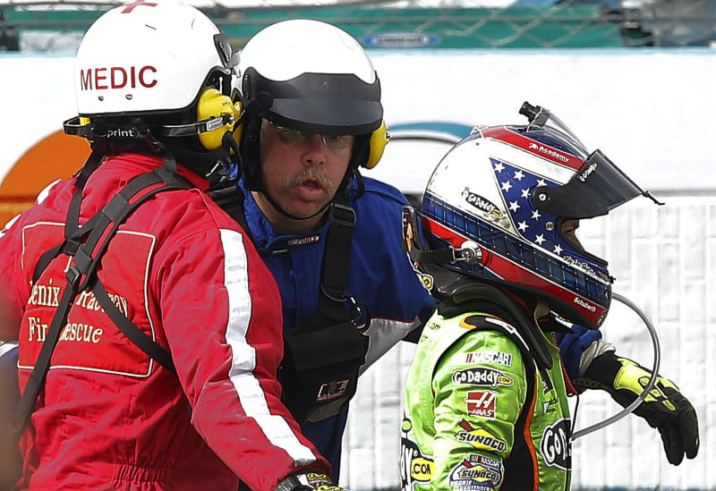 Danica Patrick heads to the infield medical center after crashing during the NASCAR Sprint Cup Series auto race, Sunday, March 3, 2013, in Avondale, Ariz. (AP Photo/Matt York)
