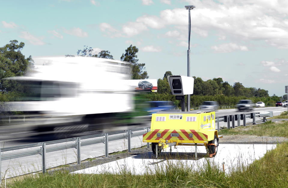 A mobile speed camera is seen on the M1 motorway, south of Brisbane.