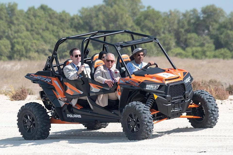 <p>During Prince Charles and Camilla Parker-Bowles' tour of the United Arab Emirates back in November 2016, the royal took to the road in a four-by-four quad. <em>[Photo: Getty]</em> </p>