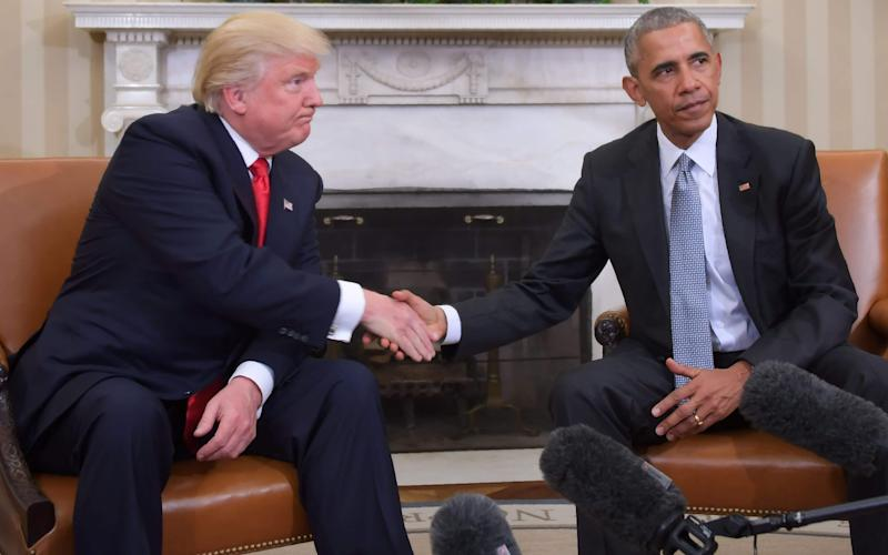 President Obama and President-elect Trump during a transition planning meeting - AFP or licensors