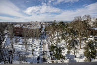 A general view after a heavy snowfall in downtown Madrid, Spain, Sunday, Jan. 10, 2021. A large part of central Spain including the capital of Madrid are slowly clearing snow after the country's worst snowstorm in recent memory. (AP Photo/Manu Fernandez)