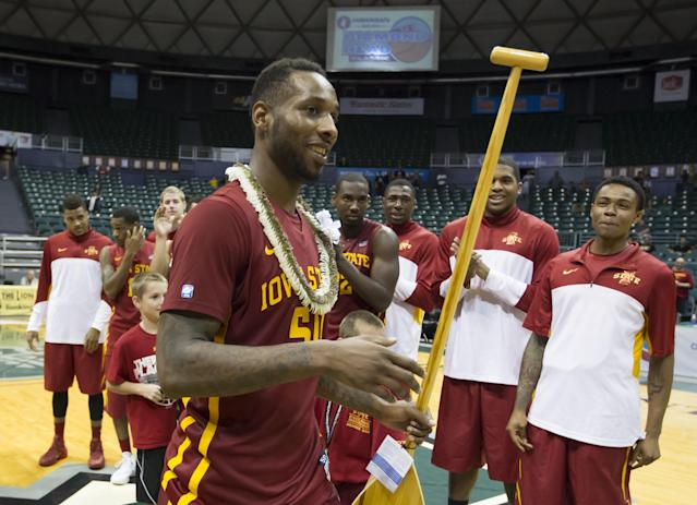 Iowa State guard DeAndre Kane (50) holds the award after being most valuable player at the Diamond Head Classic on Wednesday, Dec. 25, 2013, in Honolulu. Iowa State defeated Boise State 70-66 in an NCAA college basketball game to win the tourney. (AP Photo/Eugene Tanner)