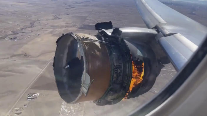 """FILE - In this image taken from video, the engine of United Airlines Flight 328 is on fire after after experiencing """"a right-engine failure"""" shortly after takeoff from Denver International Airport, Saturday, Feb. 20, 2021, in Denver, Colo. Federal safety officials are updating their investigation into the engine failure on the United Airlines plane that sent parts of the engine housing raining down on Denver-area neighborhoods last month. The National Transportation Safety Board said Friday, March 5, that a microscopic exam confirmed that a fan blade that snapped off had telltale signs of fatigue — tiny cracks caused by wear and tear. (Chad Schnell via AP)"""