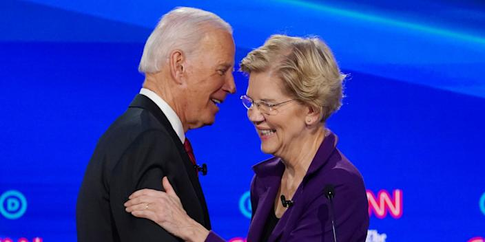 FILE PHOTO: Democratic presidential candidate and former Vice President Joe Biden shakes hands with and hugs Senator Elizabeth Warren after a question about their ages during the fourth U.S. Democratic presidential candidates 2020 election debate at Otterbein University in Westerville, Ohio U.S., October 15, 2019. REUTERS/Shannon Stapleton