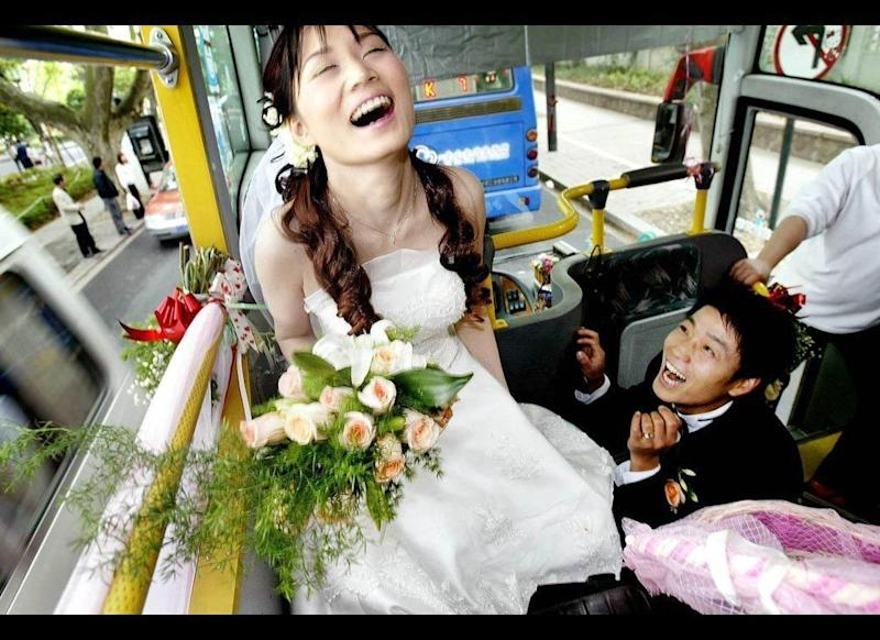 Bridal Bus: For this Chinese couple, their wedding was a public affair. They wed aboard the top level of a double-decker bus in Hangzhou, China, on April 23, 2005. The public bus route took the pair around the West Lake region of the city, a pretty, scenic place for a wedding.