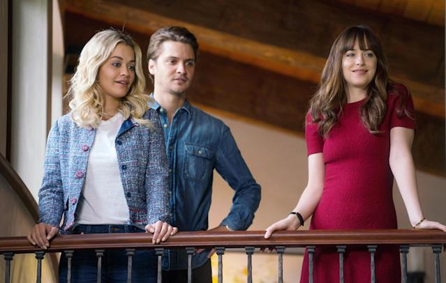 "Rita Ora, Luke Grimes, and Dakota Johnson are amazed by Dornan's rendition of ""Maybe I'm Amazed"" in <em>Fifty Shades Freed</em>. (Photo: Doane Gregory/Universal Pictures/courtesy Everett Collection)"