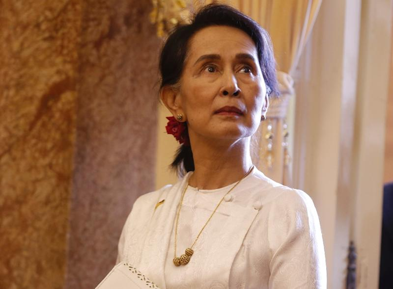Suu Kyi, once garlanded as a global rights champion, has seen a sharp fall from grace due to her failure to speak up following a brutal military crackdown on Myanmar's Rohingya minority (AFP Photo/KHAM)