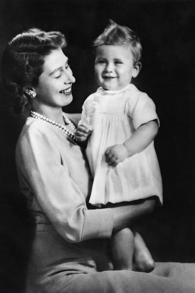 <p>Posing with his mother, Queen Elizabeth II, for a portrait. </p>