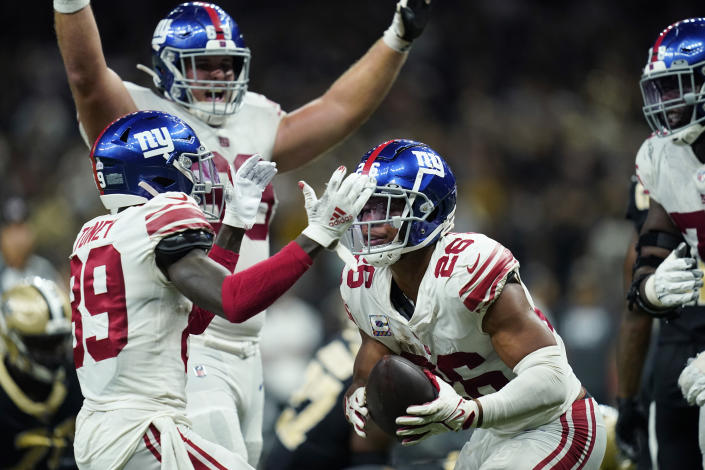 New York Giants running back Saquon Barkley (26) celebrates his touchdown in overtime with wide receiver Kadarius Toney (89) to defeat the New Orleans Saints 27-21, during an NFL football game in New Orleans, Sunday, Oct. 3, 2021. (AP Photo/Brett Duke)