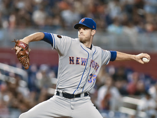 New York Mets pitcher Steven Matz delivers a pitch during the first inning of a baseball game against the Miami Marlins in Miami Sunday, July 1, 2018. (AP Photo/Gaston De Cardenas)