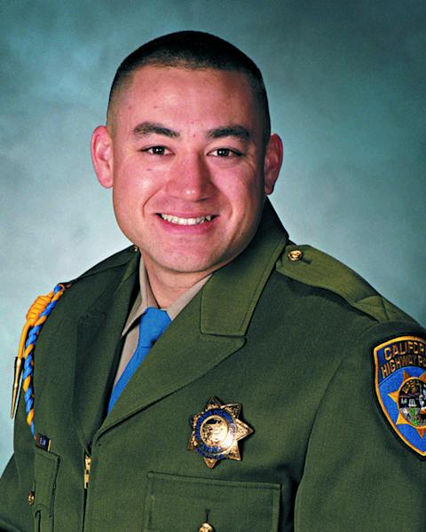 In this undated photo released by the California Highway Patrol is Officer Brian Law. The California Highway Patrol was mourning the loss of two officers Monday, Feb. 17, 2014, after their squad car flipped over while responding to a multi-vehicle crash. Officers Brian Law and Juan Gonzalez were heading to the crash on state Route 99 near the Central Valley town of Kingsburg, Calif., the CHP said. (AP Photo/California Highway Patrol)